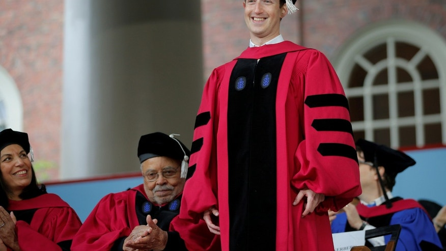 Facebook founder Mark Zuckerberg stands to receive an honorary Doctor of Laws degree during the 366th Commencement Exercises at Harvard University in Cambridge, Massachusetts, U.S., May 25, 2017. (REUTERS/Brian Snyder)