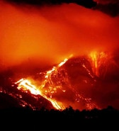 The Pacaya volcano, located 24 miles south of the capital, explodes late November 11 setting off mile-long lava-flows and spewing a column of ash nearly two miles into the air. Sixty four people from the village El Caracol, who were evacuated, have begun to return home. - RTXGG1E