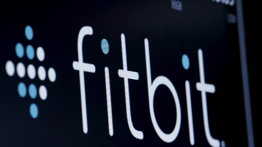 File photo: The ticker symbol for Fitbit is displayed at the post where it is traded on the floor of the New York Stock Exchange (NYSE) February 23, 2016. (REUTERS/Brendan McDermid)