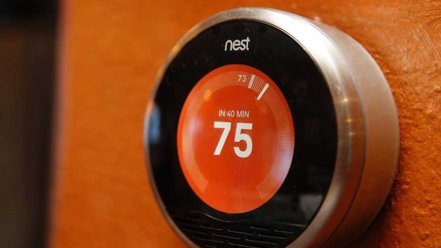 File photo: A Nest thermostat is installed in a home in Provo, Utah, January 15, 2014. (REUTERS/George Frey)