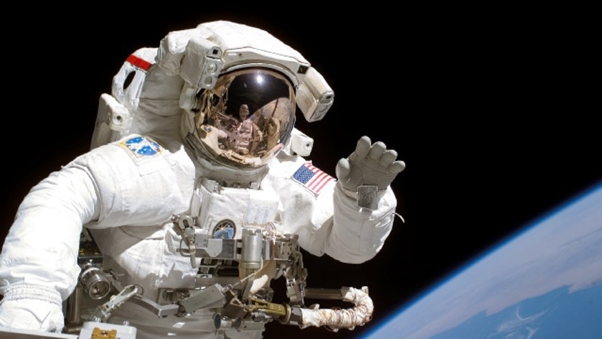 Astronaut Joseph Tanner, STS-115 mission specialist, waves at the camera during a spacewalk in 2006. NASA will announce the latest additions to its astronaut corps on June 7.
