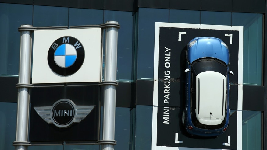File photo: A Mini car is fixed onto a wall at a BMW and Mini dealership in Barcelona, Spain June 2, 2017. (REUTERS/Albert Gea)