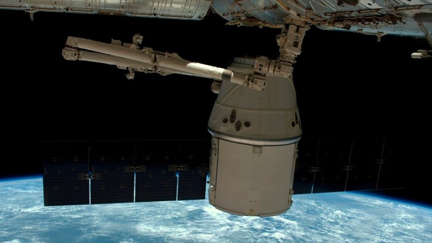 A NASA photo shows a SpaceX Dragon capsule as it is released from the International Space Station in this image released to social media on May 11, 2016. (NASA)