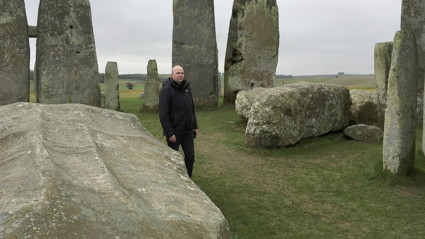 File photo: Doctor Rupert Till, music technologist from the University of Huddersfield, poses for a photograph in the stone circle of the ancient monument of Stonehenge, Amesbury, Britain February 22, 2017. Till has co-developed an app that gives users a virtual acoustic tour of Stonehenge as it would have sounded thousands of years ago with all the stones in their original place, complete with soundtrack of Neolithic 'music'. (REUTERS/Matthew Stock)