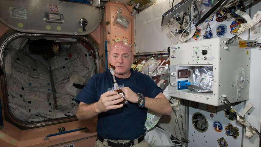 File photo: NASA astronaut Scott Kelly enjoys his first drink from the new ISSpresso machine aboard the International Space Station, May 3, 2016. The espresso device allows crews to make tea, coffee, broth, or other hot beverages they might enjoy. (REUTERS/NASA/Handout)