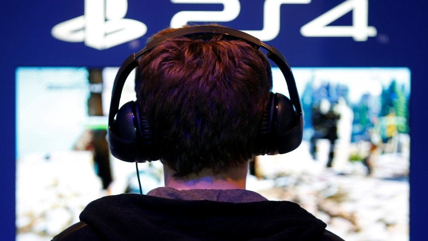 File photo: A visitors plays games on PlayStation 4 (PS4) at the Paris Games Week, a trade fair for video games in Paris, France, October 29, 2016. (REUTERS/Charles Platiau)