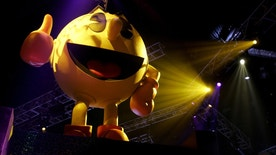 Pac-Man sits atop a display for video game maker Namco at the E3 Convention at the Los Angeles Convention Center, May 19, 2005. The giants in the $10 billion video gaming industry wrap up their annual meeting May 20, 2005. REUTERS/Sam Mircovich  SM/HK