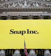 A banner for Snap Inc. hangs from the front of the New York Stock Exchange, Thursday, March 2, 2017, in New York. The company behind the popular messaging app Snapchat is expected to start trading Thursday after a better-than-expected stock offering. (AP Photo/Mark Lennihan)