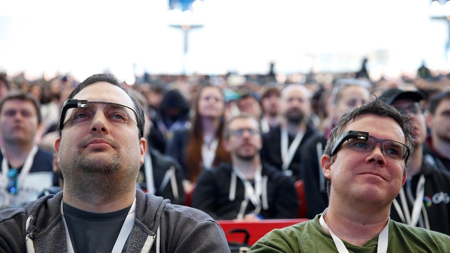 File photo: Two attendees wearing Google Glass listen to the opening keynote during the annual Google I/O developers conference in San Jose, California, U.S., May 17, 2017. (REUTERS/Stephen Lam)