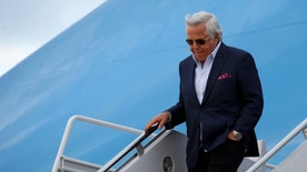 New England Patriots owner Robert Kraft steps from Air Force One upon his arrival with U.S. President Donald Trump at Joint Base Andrews in Maryland, U.S., March 19, 2017.  REUTERS/Kevin Lamarque - RTX31RN7