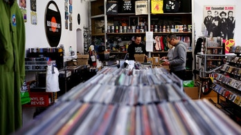 Employees check vinyl albums in the Recordbag shop ahead of the International Record Store day in Vienna, Austria, April 21, 2017.  REUTERS/Leonhard Foeger - RTS13BT0