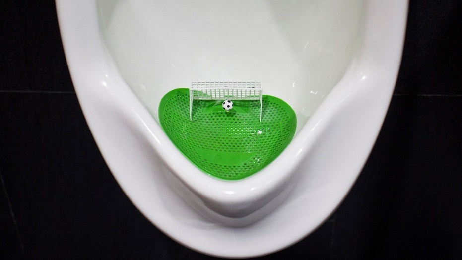 File photo: An urinal filter designed in the likeness of a soccer field with a goal post and a ball is pictured after a renovation in a men's room of a shopping mall promoting the 2014 Brazil World Cup, in Shanghai June 23, 2014. (REUTERS/Aly Song)