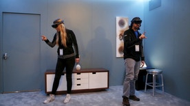 Microsoft employees demonstrate HoloLens during the Microsoft Build 2016 Developers Conference in San Francisco, California March 30, 2016. REUTERS/Beck Diefenbach - RTSCWQJ