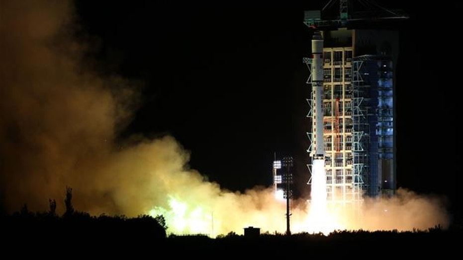 In this photo released by China's Xinhua News Agency, a rocket carrying the world's first quantum satellite lifts off from the Jiuquan Satellite Launch Center in Jiuquan in China's Gansu province on Aug. 16, 2016.