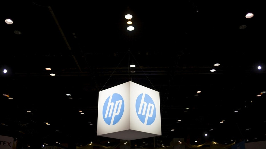 File photo: The Hewlett-Packard (HP) logo is seen as part of a display at the Microsoft Ignite technology conference in Chicago, Illinois, May 4, 2015. (REUTERS/Jim Young)