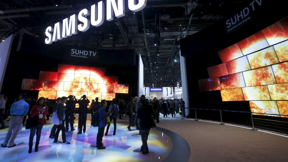 "File photo: ""Quantum Dot"" SUHD televisions are displayed at the Samsung Electronics booth during the 2016 CES trade show in Las Vegas, Nevada January 7, 2016. The quantum dot technology creates a brighter picture and a wider range of color than conventional LED TVs, a representative said. (REUTERS/Steve Marcus)"