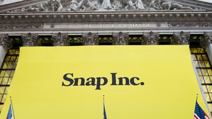 File photo: A banner for Snap Inc. hangs from the front of the New York Stock Exchange, Thursday, March 2, 2017, in New York. (AP Photo/Mark Lennihan)  (Copyright 2017 The Associated Press. All rights reserved.)