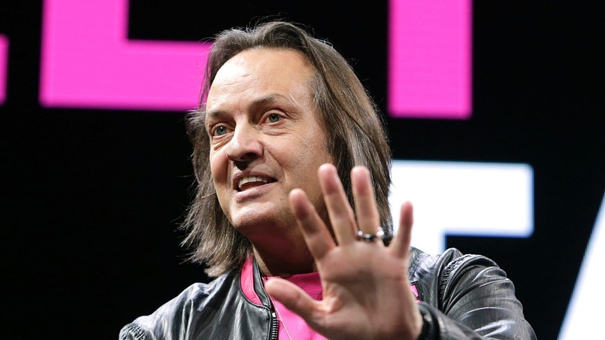 File photo: T-Mobile US President and CEO John Legere announced the addition of 2.1 million net customers in the fourth quarter and 8.2 million net customers for 2016 during the Un-carrier Next event at CES on Thursday, Jan. 5, 2017, in Las Vegas. (Bizuayehu Tesfaye/AP Images for T-Mobile)