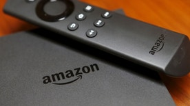 The new Amazon Fire TV is displayed during a media event introducing new Amazon products in San Francisco, California September 16, 2015. Amazon on Thursday rolled out a line of tablets and revamped Fire TV gadgets. The $99.99 Fire TV set-top box integrates its cloud-based virtual assistant Alexa, allowing viewers to check the weather, look up sports scores and play music. Photo taken September 16, 2015.  REUTERS/Beck Diefenbach - RTS1KUO