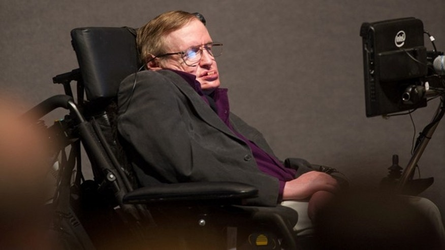 "File photo: April 9, 2013: British cosmologist Stephen Hawking, who has motor neuron disease and amyotrophic lateral sclerosis (ALS), gives a talk titled ""A Brief History of Mine,"" to workers at Cedars-Sinai Medical Center in Los Angeles.  (AP Photo/Cedars-Sinai, Eric Reed)"