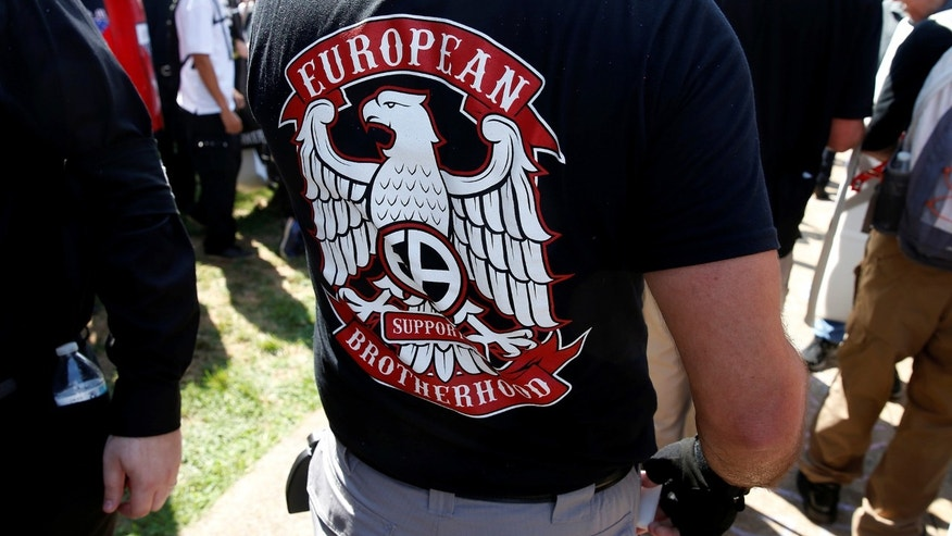 "File photo - A white supremacist wears a shirt with the slogan ""European Brotherhood"" at a rally in Charlottesville, Virginia, U.S., Aug. 12, 2017. (REUTERS/Joshua Roberts)"