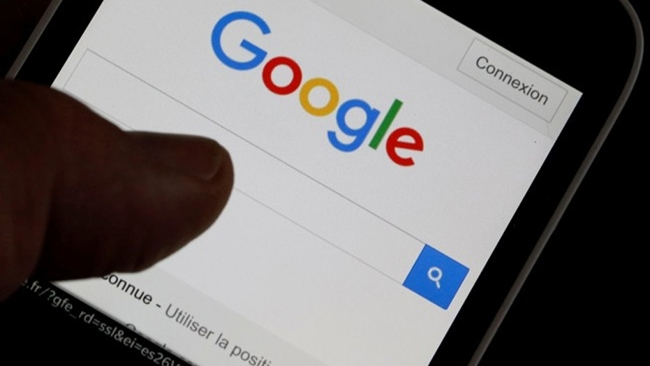 File photo:  man holds his smartphone which displays the Google home page, in this picture illustration taken in Bordeaux, Southwestern France, August 22, 2016. (REUTERS/Regis Duvignau)