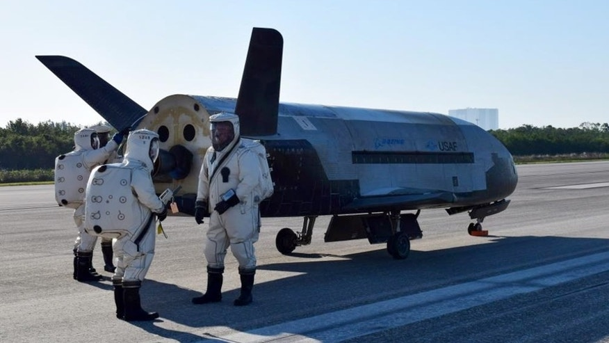 The U.S. Air Force's robotic X-37B space plane sits on the Shuttle Landing Facility runway at NASA's Kennedy Space Center shortly after a May 7, 2017, landing that ended the 718-day OTV-4 mission.