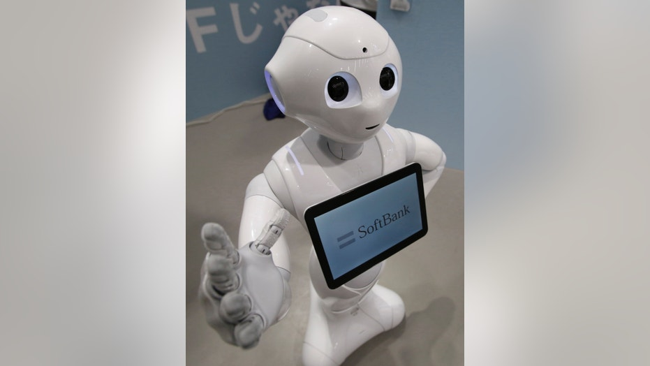 File photo - SoftBank Corp's human-like robot named 'pepper' is displayed at its branch in Tokyo June 6, 2014.