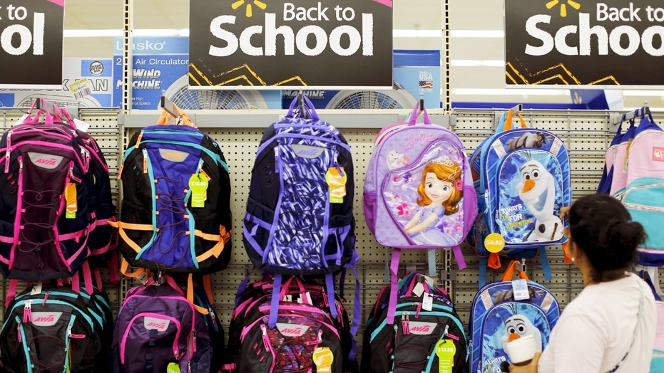 File photo: A woman shops for back to school supplies at a Walmart store in San Diego, California, U.S. August 6, 2015. (REUTERS/Mike Blake)