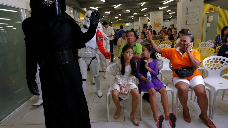 File photo: Members of a Star Wars fan club in Thailand, dressed as Kylo Ren, entertains children during Star Wars Day celebration at the Queen Sirikit National Institute of Child Health in Bangkok, Thailand, May 4, 2016. (REUTERS/Chaiwat Subprasom)