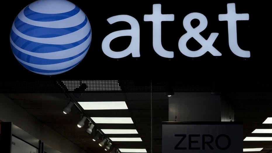 File photo: An AT&T logo is seen at an AT&T store in New York City, October 23, 2016. (REUTERS/Stephanie Keith)