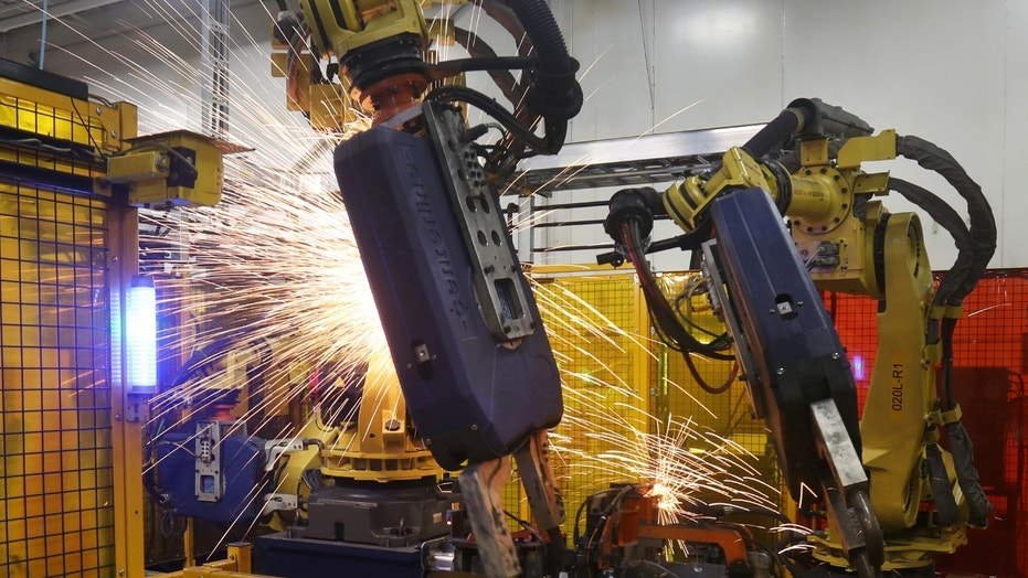 Robot welders on the floor of Alfield Industries, a subsidiary of Martinrea, one of three global auto parts makers in Canada, in Vaughan, Ontario, Canada April 28, 2017. Picture taken April 28, 2017. REUTERS/Fred Thornhill - RTX36NMN