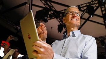 Tim Cook, CEO, holds an iPad Pro after his keynote address to Apple's annual world wide developer conference (WWDC) in San Jose, California, U.S. June 5, 2017. REUTERS/Stephen Lam  TPX IMAGES OF THE DAY - HP1ED651LWP5I
