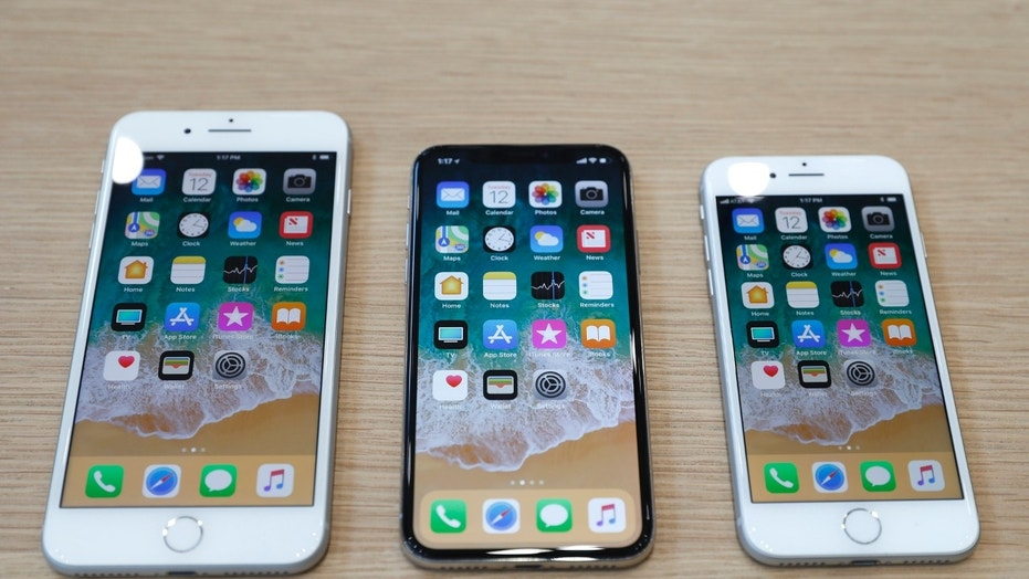 (L-R) iPhone 8 Plus, iPhone X and iPhone 8 models are displayed during an Apple launch event in Cupertino, California, U.S. Sept. 12, 2017. (REUTERS/Stephen Lam)