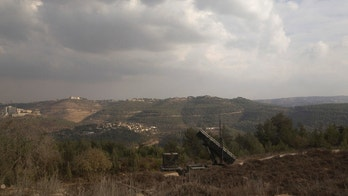 "A Patriot anti-missile battery is seen west of Jerusalem, during ""Austere Challenge 2012"", a joint Israeli-hosted exercise with U.S. forces October 23, 2012. The three-week drill, the largest the allies have ever held, simulates a variety of long and short-range missile attacks that Israel could face during a regional conflict, said the commanders in charge. REUTERS/Ronen Zvulun (ISRAEL - Tags: POLITICS MILITARY) - GM1E8AN1Q4Y01"