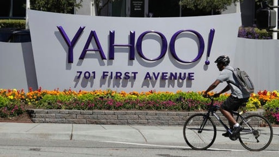FILE - In this Tuesday, July 19, 2016 file photo, a cyclist rides past a Yahoo sign at the company's headquarters in Sunnyvale, Calif. (AP Photo/Marcio Jose Sanchez) (Copyright 2016 The Associated Press. All rights reserved.)