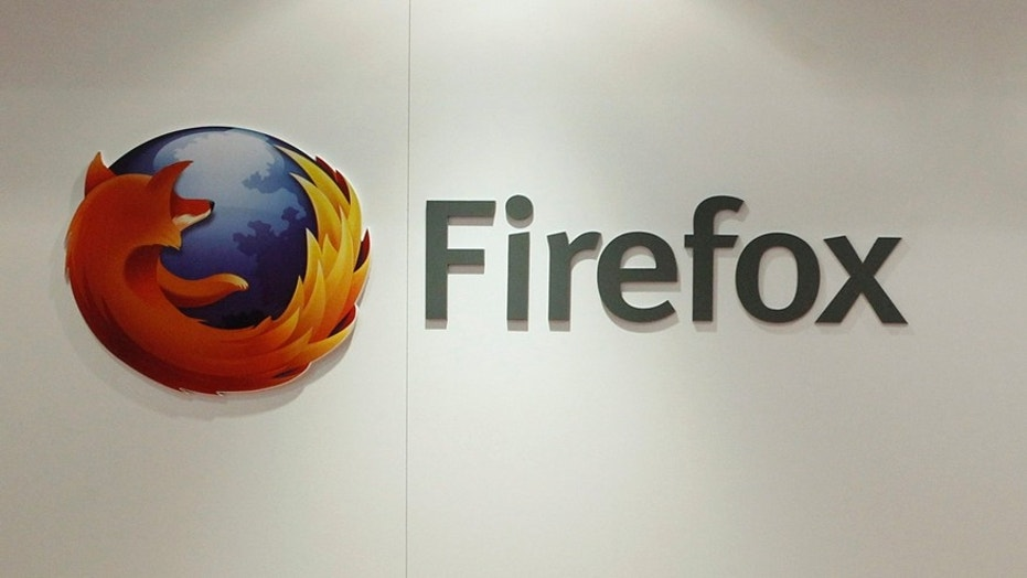File photo - a Firefox logo at a Mozilla stand during the Mobile World Congress in Barcelona, Feb. 28, 2013. (REUTERS/Albert Gea)