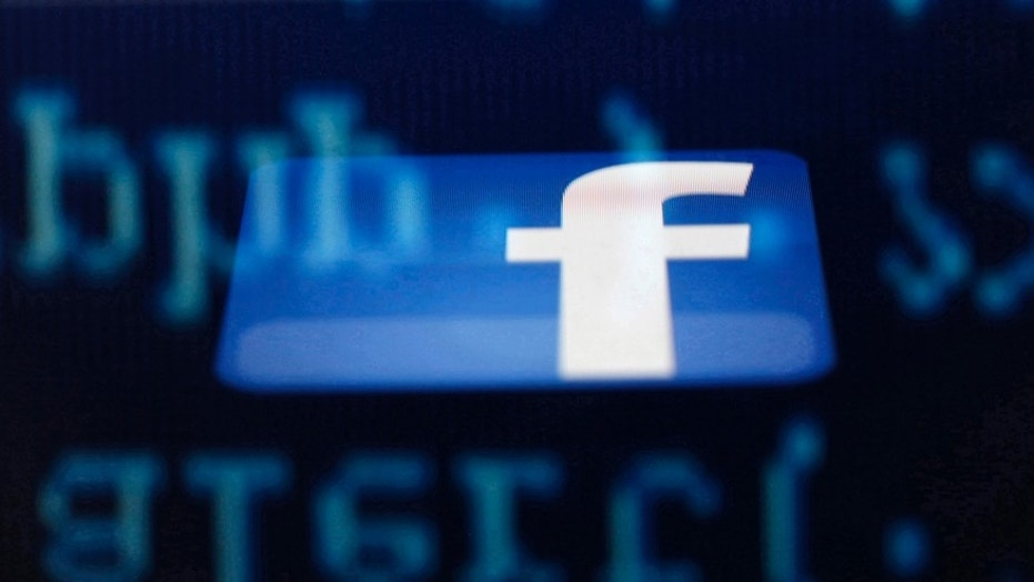 File photo - A Facebook logo on an Ipad is reflected among source code on the LCD screen of a computer, in this photo illustration taken in Sarajevo June 18, 2014. (REUTERS/Dado Ruvic)