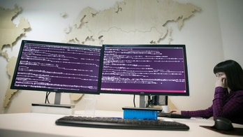 A computer code is seen on displays in the office of Global Cyber Security Company Group-IB in Moscow, Russia, Wednesday, Oct. 25, 2017. A new strain of malicious software has paralyzed computers at a Ukrainian airport, the Ukrainian capital's subway and at some independent Russian media. Moscow-based Global Cyber Security Company Group-IB said in a statement Wednesday the ransomware called BadRabbit also tried to penetrate the computers of major Russian banks but failed. None of the banks has reported any attacks. (AP Photo/Pavel Golovkin)