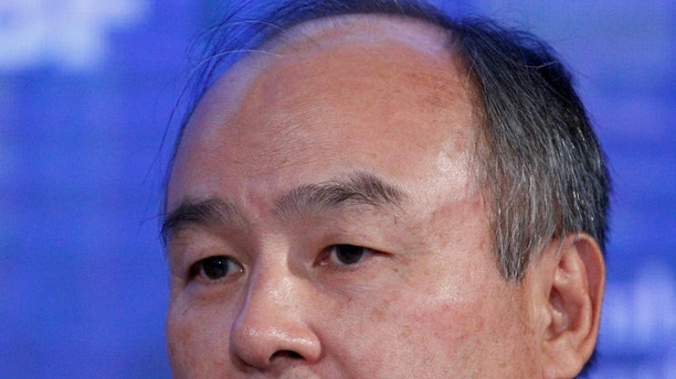 SoftBank Group Corp. Chairman and CEO Masayoshi Son speaks at the Bloomberg Global Business Forum in New York City, U.S., September 20, 2017. REUTERS/Brendan McDermid - RC16E8410BC0