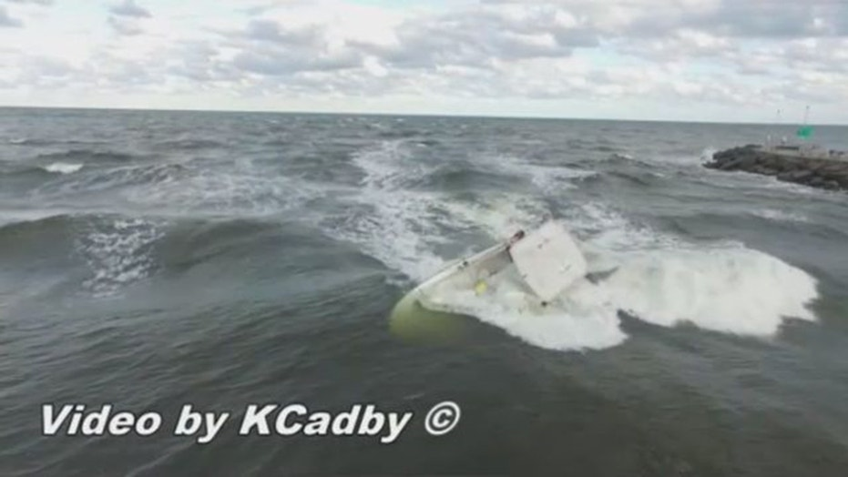 A drone captured video of a boat capsizing in Florida and a daring rescue by a nearby 13-year-old surfer. (Kevin Cadby)