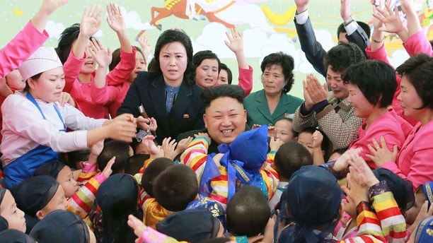 North Korean leader Kim Jong Un (C) poses for a picture with children during a visit to the Pyongyang Baby Home and Orphanage on New Year's Day in this photo released by North Korea's Korean Central News Agency (KCNA) in Pyongyang January 2, 2015. REUTERS/KCNA (NORTH KOREA - Tags: POLITICS)   ATTENTION EDITORS - THIS PICTURE WAS PROVIDED BY A THIRD PARTY. REUTERS IS UNABLE TO INDEPENDENTLY VERIFY THE AUTHENTICITY, CONTENT, LOCATION OR DATE OF THIS IMAGE. FOR EDITORIAL USE ONLY. NOT FOR SALE FOR MARKETING OR ADVERTISING CAMPAIGNS. THIS PICTURE IS DISTRIBUTED EXACTLY AS RECEIVED BY REUTERS, AS A SERVICE TO CLIENTS. NO THIRD PARTY SALES. NOT FOR USE BY REUTERS THIRD PARTY DISTRIBUTORS. SOUTH KOREA OUT. NO COMMERCIAL OR EDITORIAL SALES IN SOUTH KOREA - GM1EB1216RU01