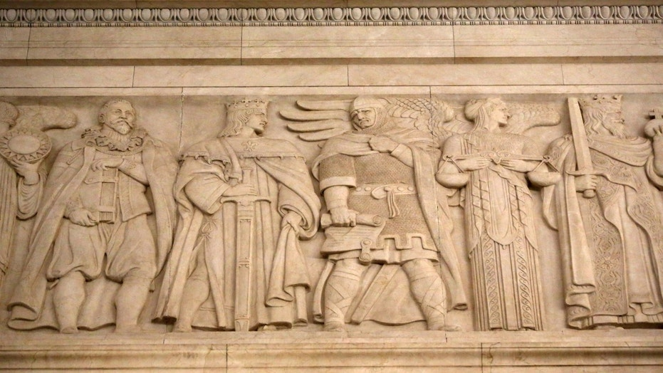 File photo: Historical and mythical figures of the law are seen in a frieze in the courtroom of the U.S. Supreme Court in Washington, U.S. April 4, 2016. (REUTERS/Jonathan Ernst)