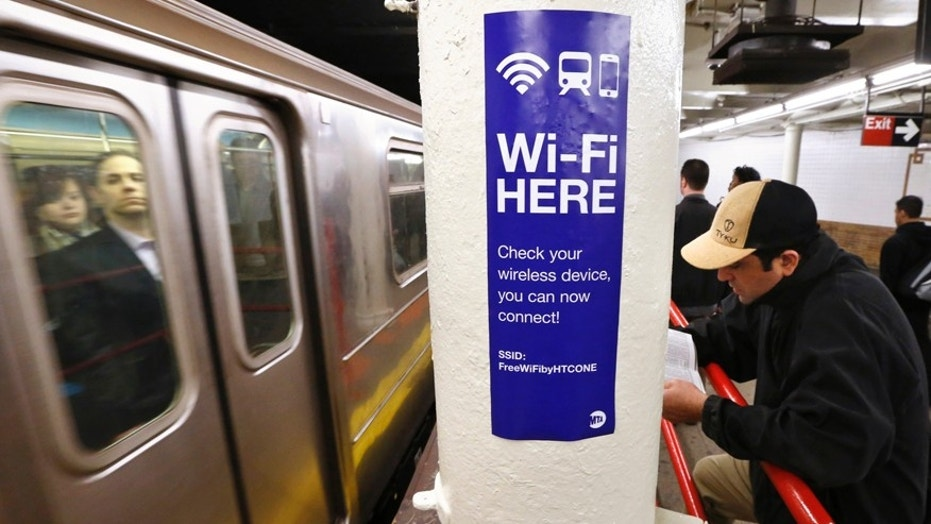 A sign advertises Wi-Fi service in the Times Square Subway station in New York, April 25, 2013. (REUTERS/Brendan McDermid)