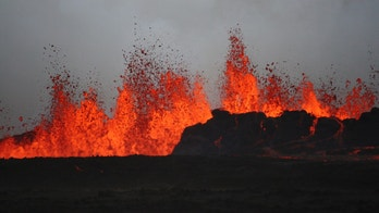 The lava flows on the ground after the Bardabunga volcano erupted again on August 31, 2014. Scientists estimate the fissure to be at least 1.5 kilometres long. The lava is estimated to be six to eight metres thick and flowing at a rate of about 1,000 cubic metres per second. Iceland cut its ash warning level for aviation to orange from red on Sunday, saying a fresh fissure eruption in Iceland's Bardarbunga volcano system was not creating ash. Iceland's largest volcanic system, which cuts a 190 km long and up to 25 km wide (118 miles by 15.5 miles) swathe across the North Atlantic island, has been hit by thousands of earthquakes over the last two weeks and scientists have been on high alert. ? REUTERS/Armann?Hoskuldsson?(ICELAND - Tags: DISASTER ENVIRONMENT TPX IMAGES OF THE DAY) - GM1EA9109GC01