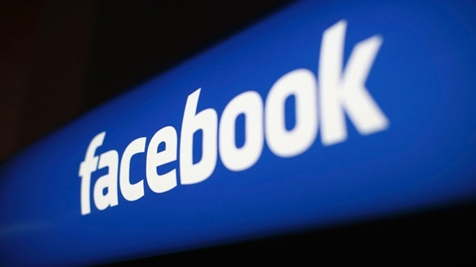 The Facebook logo is pictured at the Facebook headquarters in Menlo Park, California.