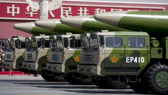 Military vehicles carrying DF-26 ballistic missiles travel past Tiananmen Gate during a military parade to commemorate the 70th anniversary of the end of World War II in Beijing Thursday Sept. 3, 2015. REUTERS/Andy Wong/Pool - GF10000191342
