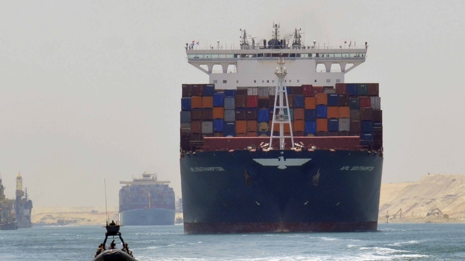 File photo - A cargo ship is seen crossing through the New Suez Canal, Ismailia, Egypt, July 25, 2015. (REUTERS/Stringer)