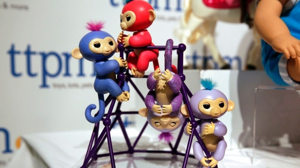 This Tuesday, Sept. 26, 2017, photo shows Fingerlings from WowWee on display at the 2017 TTPM Holiday Showcase in New York. Shoppers rushing to find Fingerlings, the robotic monkeys that are one of the holiday season's hottest toys and already hard to find, say they've been fooled into buying fakes. (AP Photo/Richard Drew)