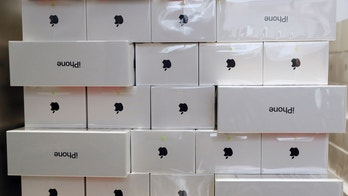 Boxes of iPhone X are pictured during its launch at the Apple store in Singapore November 3, 2017. REUTERS/Edgar Su - RC1B194AF330